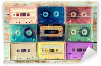Fototapeta Pixerstick Pohled shora (viz výše) záběr retro kazety s páskou na dřevěném stole - vintage barevné styly efekt.