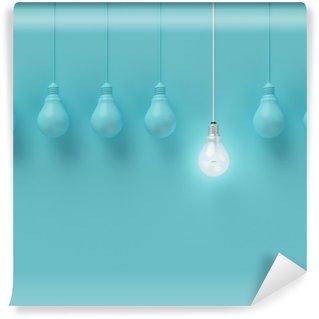 Fototapeta Pixerstick Visí žárovky s zářící jednu jinou představu o světle modrém pozadí, minimální koncept nápad, ploché laické uživatele, nahoře