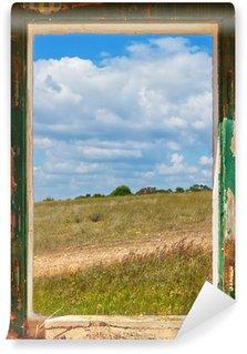 Vinylová Fototapeta Pohled na krajinu ze starého okna.