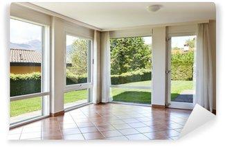 Fototapeta Winylowa Pokój z podłogą z terakoty,. okna z widokiem na ogród
