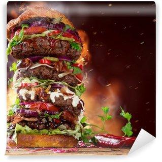 Fototapeta Winylowa Pyszne duży hamburger na drewnie