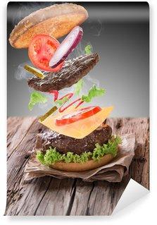 Fototapeta Winylowa Pyszne hamburger na drewnie
