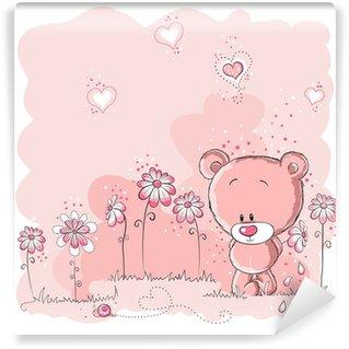 Fototapeta Vinylowa Różowy ładny miś trzyma kwiat