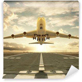 Fototapeta Winylowa Samolot startuje o zachodzie słońca