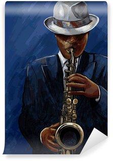 Vinylová Fototapeta Saxofonista saxofon na modrém pozadí