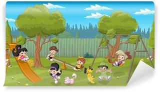 Fototapeta Winylowa Śliczne szczęśliwy cartoon dzieci bawiące się na placu zabaw na podwórku