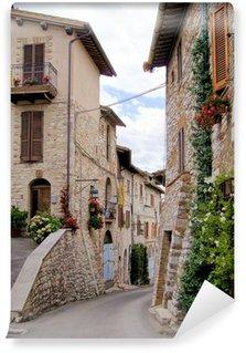 Fototapeta Vinylowa Średniowieczna ulica w włoskim wzgórzu miasta Asyżu