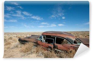 Vinylová Fototapeta Staré rezavé auto uprostřed pouště v Novém Mexiku