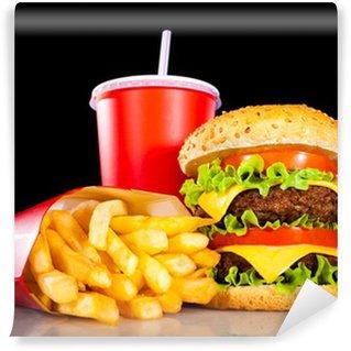 Fototapeta Winylowa Tasty hamburger i frytki na ciemno