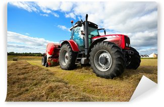 Vinylová Fototapeta Traktor shromažďování sena v oblasti