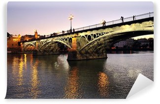 Vinylová Fototapeta Triana Bridge za soumraku, Sevilla, Španělsko