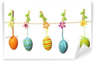 Vinylová Fototapeta Velikonoční vajíčka visí na prádelní šňůru izolovaných na bílém