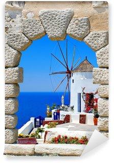 Vinylová Fototapeta Větrný mlýn přes staré okno na ostrově Santorini, Řecko
