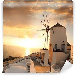 Vinylová Fototapeta Větrný mlýn v Santorini proti západu slunce, Řecko