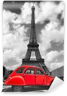 Fototapeta Vinylowa Wieża Eiffla z czerwonym starym samochodem w Paryżu, Francja