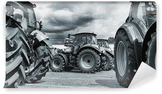 Vinylová Fototapeta Zemědělský traktor line-up, pluhy a stroje