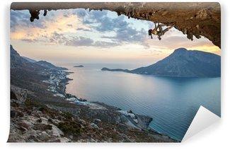 Vinylová Fototapeta Žena horolezec při západu slunce, Kalymnos Island, Řecko