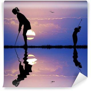 Vinylová Fototapeta Žena hraje golf při západu slunce