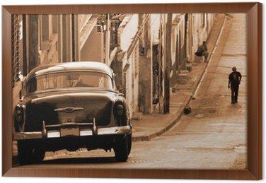 Framed Canvas A classic car in a street, Cuba