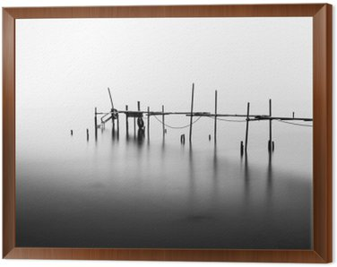 A Long Exposure of an ruined Pier in the Middle of the Sea.Processed in B&W. Framed Canvas