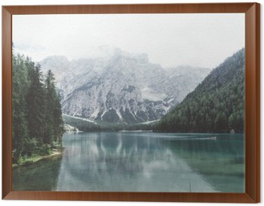 Framed Canvas Braies lake with green water and mountains with trees