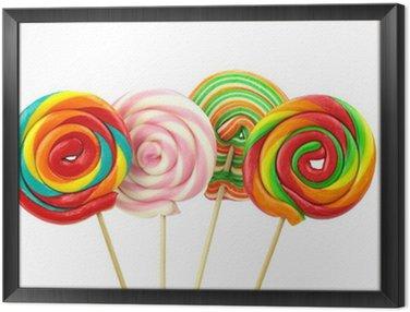Framed Canvas Colorful spiral lollipops on white background