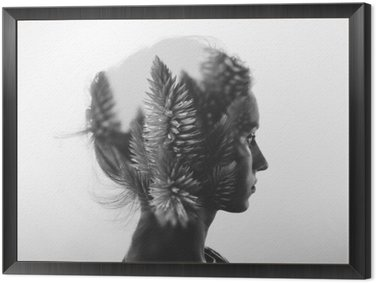 Framed Canvas Creative double exposure with portrait of young girl and flowers, monochrome