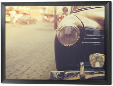 Framed Canvas Detail of headlight lamp classic car parked in urban - vintage filter effect style