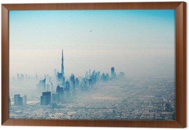 Dubai city in sunrise aerial view