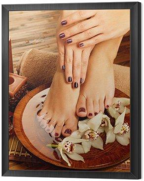 Framed Canvas female feet at spa salon on pedicure procedure