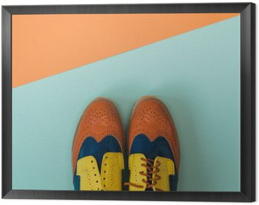 Flat lay fashion set: colored vintage shoes on colored background. Top view.