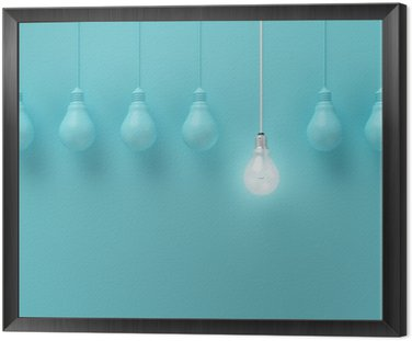 Framed Canvas Hanging light bulbs with glowing one different idea on light blue background , Minimal concept idea , flat lay , top