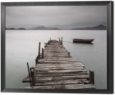 Framed Canvas Looking over a pier and a boat, low saturation