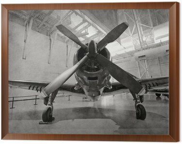 Framed Canvas Old airplane in a hangar