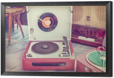 Retro styled image of an old record player Framed Canvas