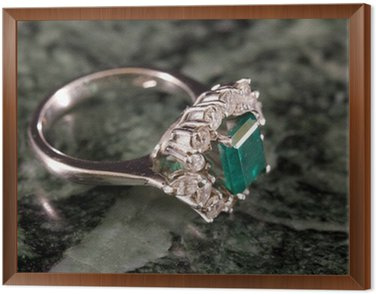 Ring with emerald and diamonds on Carrara marble