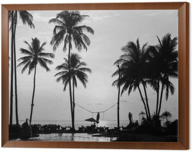 Framed Canvas Silhouettes of palm trees on a tropical beach, black and white photography.