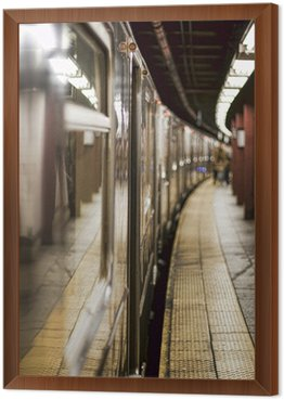 Subway train on a station Framed Canvas