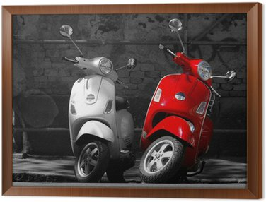 Framed Canvas This is two motorcycles in the city.