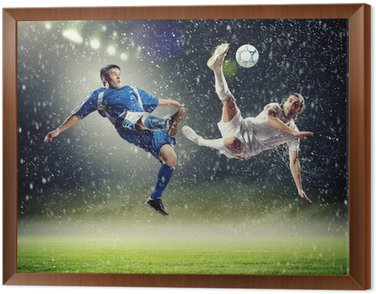 Framed Canvas two football players striking the ball