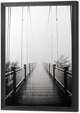 view on pedestrian wooden bridge in mist Framed Canvas