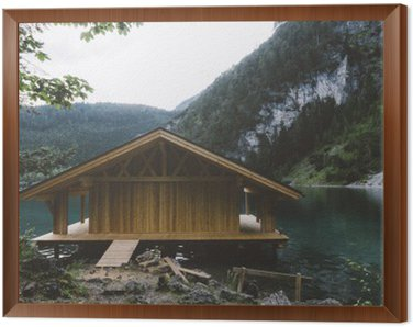 Framed Canvas Wood house on lake with mountains and trees