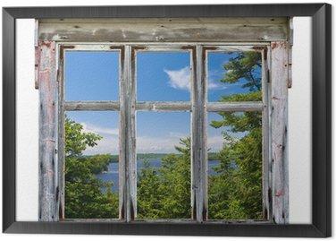 Gerahmtes Leinwandbild Szenische Ansicht durch einen alten Fensterrahmen gesehen