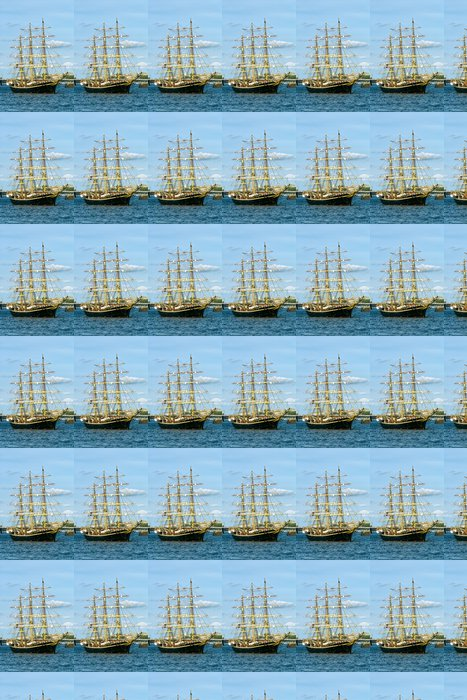 Black sailboat with yellow masts at the background of blue sky Vinyl Wallpaper - Boats