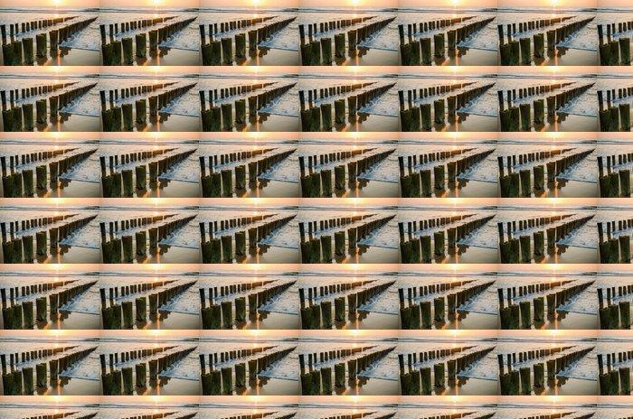 Vinylová Tapeta Vlnolamy na pláži při západu slunce v Holandsku Domburg - Témata