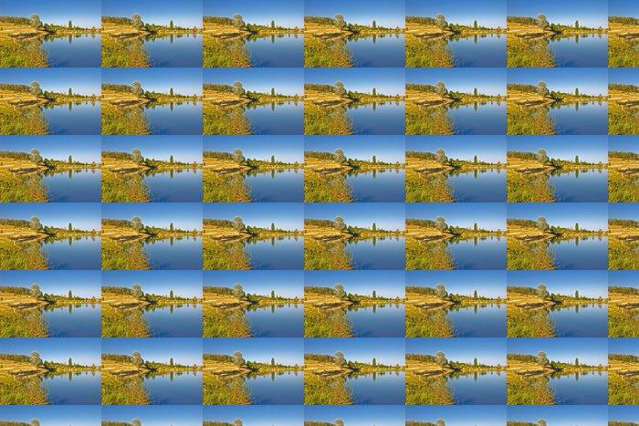 Vinylová Tapeta Modré jezero a zelené krajiny - Roční období