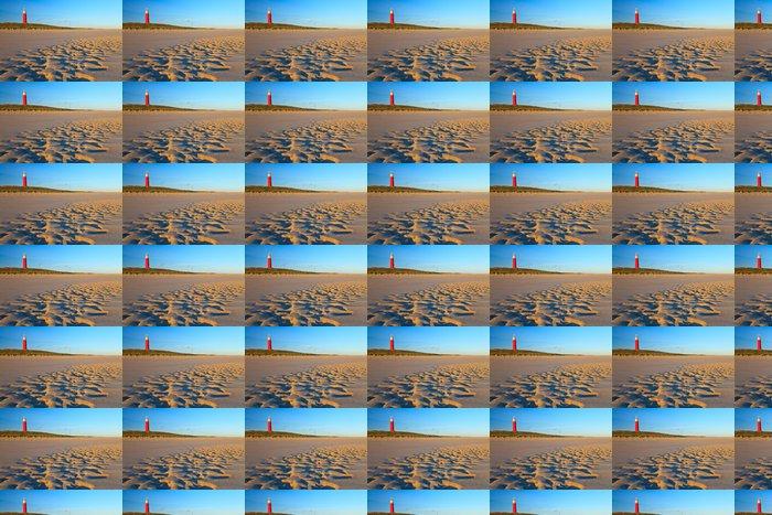 Vinylová Tapeta Přímořské s písečnými dunami a maják při západu slunce - Evropa
