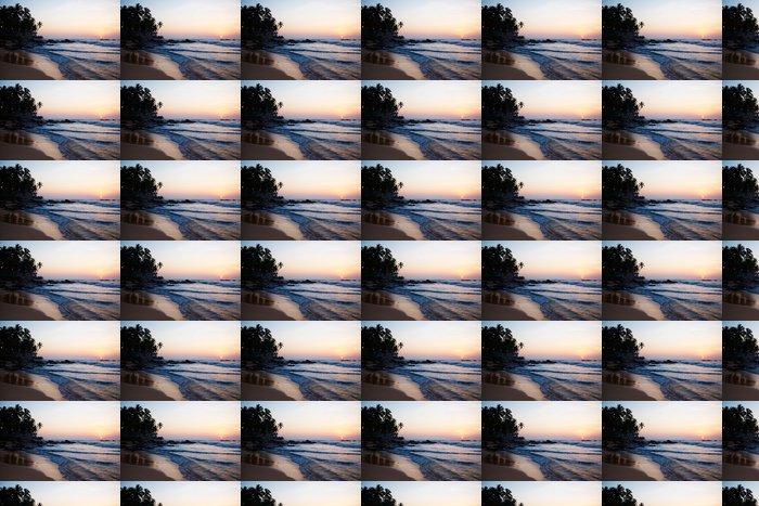 Vinylová Tapeta Krásný barevný západ slunce nad mořem a balvany vidět pod p - Prázdniny