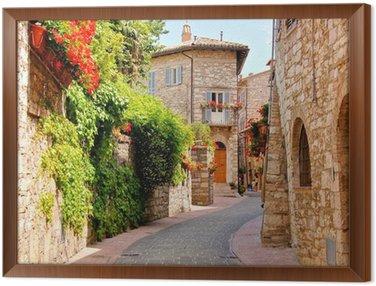 Ingelijst Canvas Bloemen omzoomde straat in het centrum van Assisi, Italië
