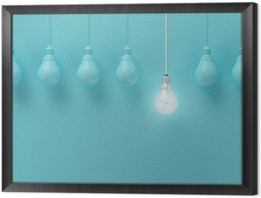 Ingelijst Canvas Opknoping gloeilampen met gloeiende een ander idee op lichte blauwe achtergrond, Minimal conceptenidee, plat, top